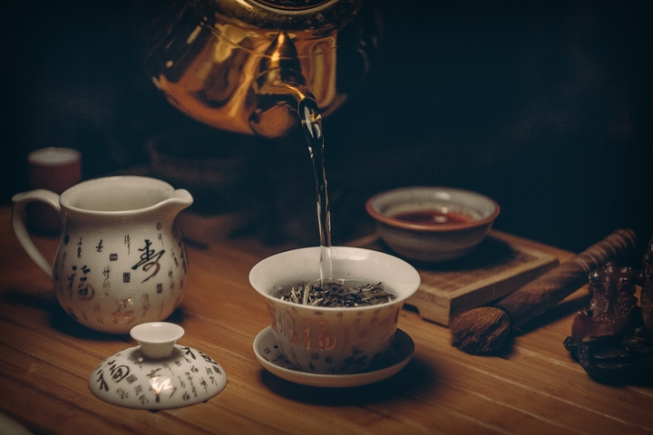 pouring water into tea cup