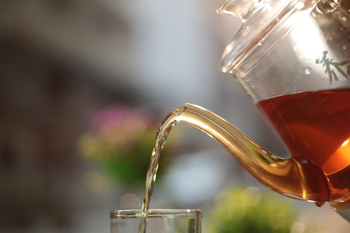 pouring a cup of organic black tea