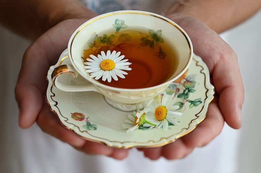 Chamomile tea in a porcelain cup