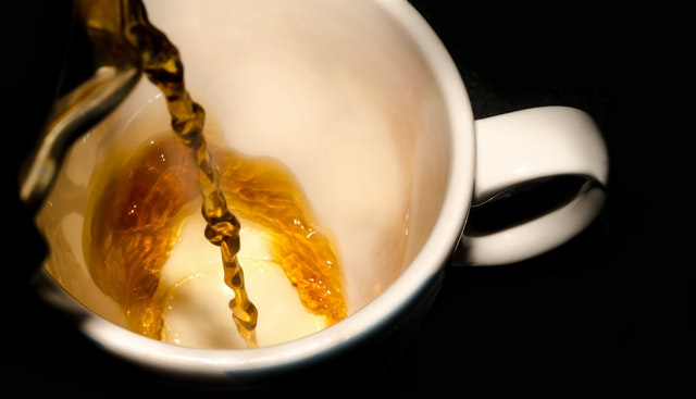 pouring a hot cup of tea