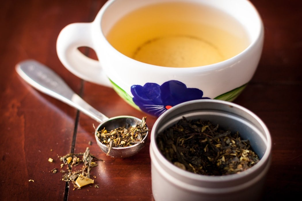 Green tea leaves and cup