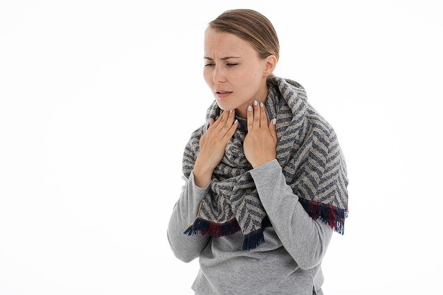 Woman Suffering With Throat Pain