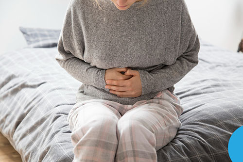 sick lady holding her stomach