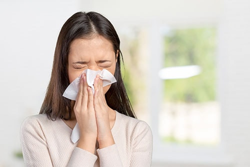 young woman suffering from an allergy