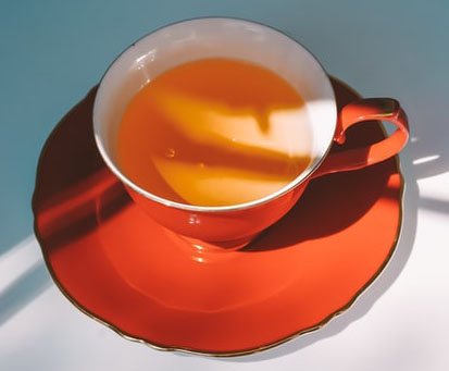 Red Ceramic Tea Cup and Saucer