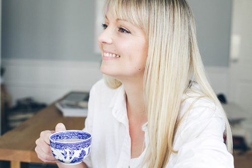 Smiling Blonde Hair Woman With A Cup Of Tea