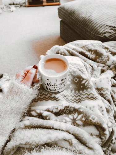 Woman In A Cozy Environment With A Cup Of Tea